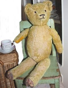 Mr. Bear has tea  Ed has a smaller version of this bear ..I believe it is a steiff bear ..his name is Tim