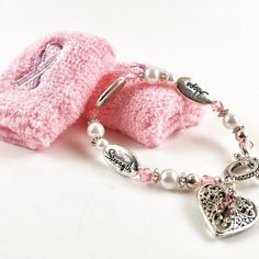 Cancer Awareness Month. Beautiful women's pink charm bracelet with sweatband  Visit us at householdoutletstore.com for all the latest news reviews and offers.  #kitchen #kitchenware #dining #utensils #cookware #kitchenutensils #cancer #cancerawareness #dinnerware #cooking #baking #charmbracelet #cracelet #pink #knives #dinnerplates #gadgets #decor #decoration #scale #dinningroom #table #crockpot #stove #stovetop #followme #women