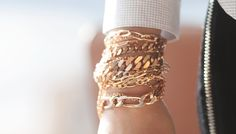 Loving the stacked gold chain bracelets