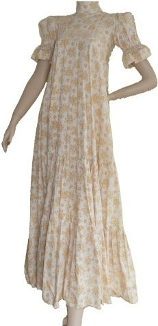 I had one similar to  this..............my most favourite dress ever!!! Mine had a square neck and was in a red and white print. Nostalgia!!!!!