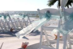 Aqua sashes dance on the breeze
