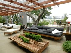 GRAY AND PALE WOOD COVERED OUTDOOR SEATING AREA! Modern contemporary outdoor garden with covered pergola terrace veranda patio deck - gray cushions on the low sofas and a gorgeous very live edge coffee table! Backyard Seating, Outdoor Seating Areas, Garden Seating, Outdoor Rooms, Backyard Patio, Outdoor Decor, Outdoor Pallet, Rustic Outdoor, Pergola Patio