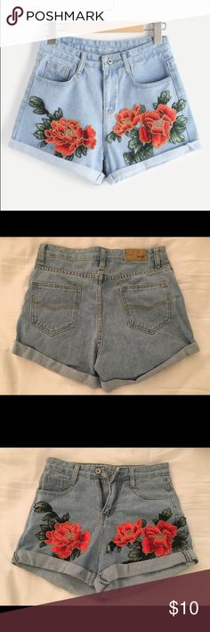 Embroidered Rolled Denim Shorts Denim shorts with embroidered appliqués. Never worn without tags. Size medium fits like a 2-4 Shorts Jean Shorts