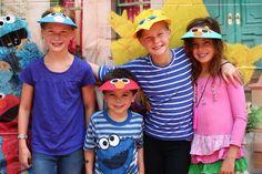 Sesame Street backdrop with Sesame Street visors