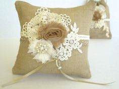 Burlap ring pillow with lace, fabric flowers and crystals. Rustic, natural wedding on Wanelo