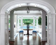 House Tour: Greenwich Home - Design Chic cased opening doors to pool