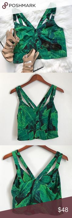 Palm Latino Print Crop Balance an edgy cropped silhouette with a bright palm print in this strappy cami. Featuring a double strap detailing with a deep V at the back for impact. Style it perfectly with denim shorts for a chic finish. 100% Viscose. Machine wash. Topshop Tops Crop Tops