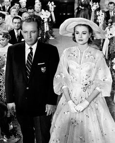 "Bing Crosby and Grace Kelly at the altar in a scene from ""High Society.""  Credit: Metro-Goldwyn-Mayer/Getty Image"