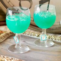 Mad Hatter Potion  Mad Hatter Potion  Makes: 6 servings  Serving size: 8 ounce  Prep: 10 mins Chill: 2 hrs  1  750 milliliter bottle white wine  1 cup orange juice  1/4 cup sugar  1/4 cup cognac or other brandy  1/4  cup blue curacao  2 cups club soda, chilled  Crushed ice (optional)