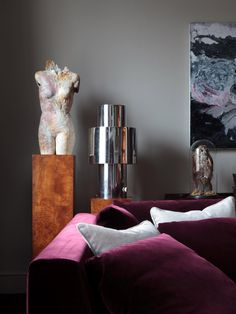 Gray and burgundy color scheme is both moody and sophisticated. Interior design by Staffan Tollgård