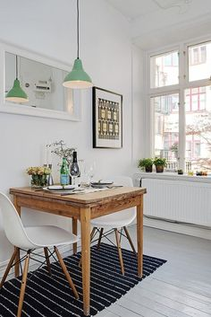 Scandinavian studio apartment inspiring a cozy, inviting ambiance. The Scandinavian minimalism comes often out of necessity: the homes are very small. This is why functional items have to look pretty - there is not much space for decorative items!