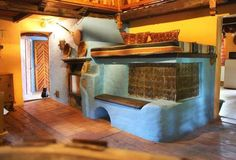 traditional central European tile stove with a sleeping loft above