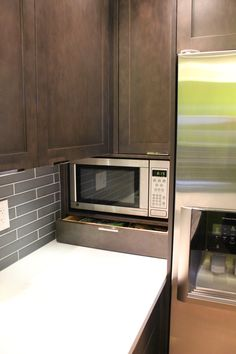 This small but efficient space features Kitchen Craft's 'Salem Solid' doorstyle in Maple 'Thunder'; countertops are Cambria 'Tourquay'. Space saving features include a built in microwave wall unit and a dishwasher drawer  http://www.kitchencraftvancouver.com/