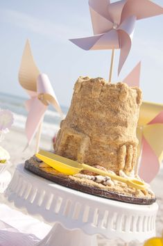Beach Birthday Party Sand Castle Cake - love the sand castle cake & pinwheels!