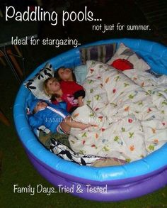 This would be an amazingly comfortable way to star gaze in the summer or enjoy watching the fireworks on the 4th of July! Blow up little pool filled with pillows and blankets