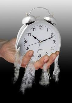 Time, Running Out of Time, dahlia, poetry about time, sand, grasping time, fingers, hand, holding onto time, clock, white clock, alarm clock