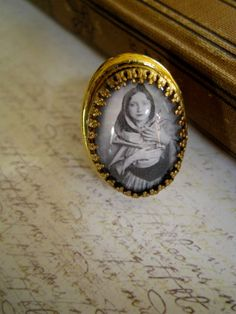 Anais Nin in goldtone.