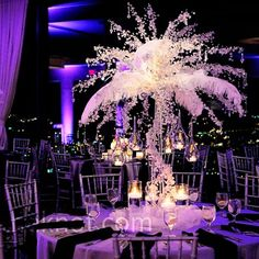 Tall Feather Centerpieces These tall, crystal-covered arrangements of branches and feathers were a major wow factor of the night. These tall, crystal-covered arrangements of branches and feathers were a major wow factor of the night. Spring Wedding Centerpieces, Feather Centerpieces, Wedding Decorations, Purple Centerpiece, Table Decorations, Decor Wedding, Wedding Table, Wedding Reception, Our Wedding