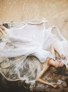 """i'm debating if i want to do """"wreck the dress"""" photos in my wedding dress."""