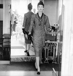 Anne St. Marie wearing tweed sheath dress with fly-front closing, hat, gloves, and high-tongued opera pumps, all by Dior, photo by Henry Clarke, Paris, 1955,
