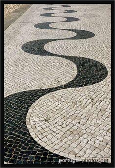 Snake patterns on the sidewalk in Nazare