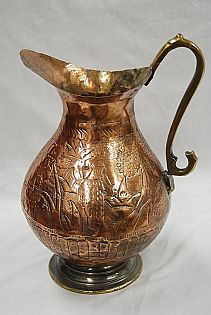Antique Copper Pitcher with Person in Garden