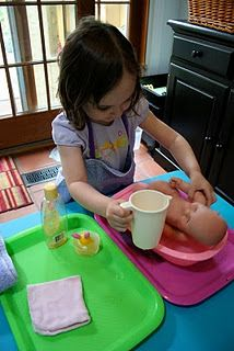 Preschool at Home: Bathing a doll. Lots of good life skills in this one.