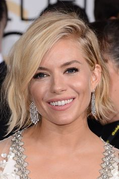 Who says a bob can't be bridal? A tousled chin-length crop is the perfect finishing touch for the irreverent bride. Sienna Miller's side-swept locks your ultimate hair muse.