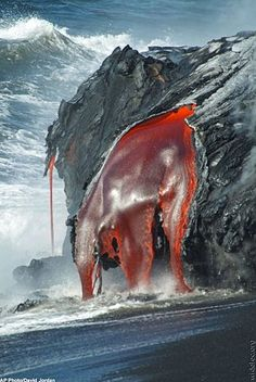 lava, actually it's magma until it cools and hardens which it will do immediately upon hitting the water. Great photo!