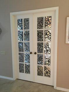 Broken mirror mosaic on french doors