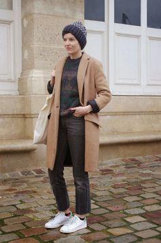 Vintage printed jumper in dark tones + camel coat + white trainers + navy beanie + dark jeans