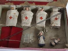 A Tessted Toys British Dolls' Field Hospital, complete with Red Cross tent, four beds, screens, a S.F.B.J. 301 bisque head doll in nurses uniform, boxed