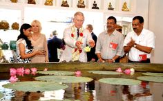 The Prince of Wales throws a flower into a giant cooking bowl big enough to feed 6,000 people, during a visit to Jew Street in Kochi