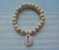Online shopping from a great selection at Shells Group Store. Cowrie Shell Necklace, Shell Bracelet, Shell Earrings, Shell Necklaces, African Bracelets, African Earrings, Beaded Bracelets, Seashell Jewelry, Beach Jewelry