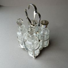 Victorian Edwardian silver plate cruet set Condiment set Mustard pot and spoon Glass jars Glass bottles Vintage serving Tableware
