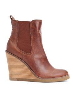 A boot like this: I don't normally like wedge heels on boots, but sometimes you see a really cute one. These would be so cute with jeans or pants.