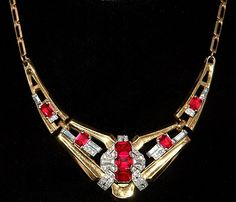 "Art Deco necklace designed by McClelland Barclay c. 1935 - 1943    ""This vintage piece can be seen in the book American Costume Jewelry by Roberto and Carla Brunialti among others. This wonderful necklace was designed by McClelland Barclay and produced by the little known Rice -Weiner company. The ruby red glass is brilliant and the clear rhinestones really pop! A great example of early costume jewelry.    During the 1920s and the 1930s he became world famous for his Art Deco jewelry."""