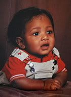 """Baltimore, MD and Philadelphia, PA – When Javon Thompson died, he was only about 18 months old. Sometime between December 2006 and February 2007, the toddler was killed and left in a green suitcase in a shed in Philadelphia. Little Javon was starved to death by the members of his mother's cult because he wouldn't – or couldn't – say """"Amen"""" at mealtime prayers. Now Javon's mother, Ria """"Princess Marie"""" Ramkissoon, and four other cult members are charged with his murder. Read more:"""