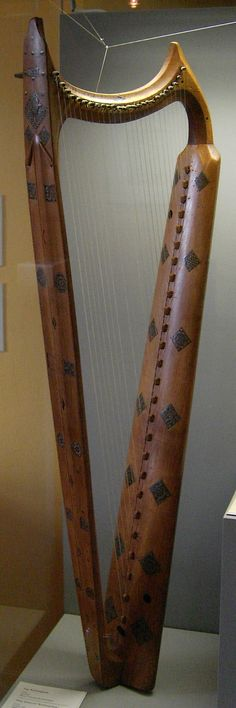 Wartburg Harp, also known as the Wolkenstein harp or the Eisenach harp, dated to the late 14th or early 15th century. 26 strings, 104cm high.  Its original strings would have been made of gut, and each string would have been fitted with a buzzing 'bray pin' which makes all of the strings buzz like a sitar. The harp is of maple wood and has lavish inlay decoration. It was made in the Tirol area and is said to have belonged to Oswald von Wolkenstein (1376/7-1445).