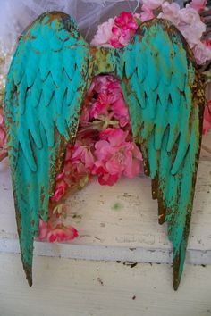Deep turquoise aqua rusty metal wings by AnitaSperoDesign on Etsy, $78.00