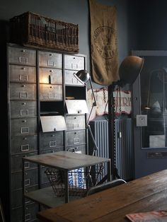 I love the locker basket on the shelf and the basket on top of the cabinet. I'm not sure if this is a file cabinet, but I like it and find the doors interesting.