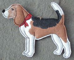 This jaunty Beagle is ready for his walk, wearing his red bandana.    I make these with freehand machine stitching on a sandwich of wool/rayon felt, cutting with tiny sharp scissors and hand painting with acrylic paints.    Painted front is colorfast- back is plain dark purple felt.  Gold hanging string.    4 1/4 x 3 1/2