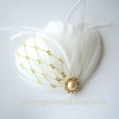 If this was bigger for an oversized look i would love!  White Feather Fascinator - PETIT DOREE - White Ostrich Feathers Gold Veil Netting Bridal Clip on Etsy, $17.72 AUD