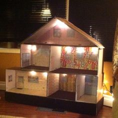 Made this dollhouse w my daughter after Xmas. Supplies: duct tape, spray adhesive, diaper boxes, xmas lights, scrapbook paper, dollar store carpet & tile!