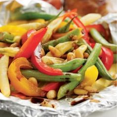 Packet-Roasted Balsamic Green Beans & Bell Peppers (Eating Well). Parchment/ foil packets can be roasted in the oven or on the grill
