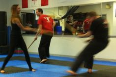 The martial artists practice with Mr McMichael before he teaches the reporter, Jill Belland, the moves. Martial Artists, The Hobbit, Wrestling, Teaching, Lucha Libre, Hobbit, Teaching Manners, Learning, Education