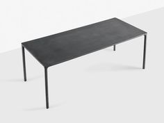 The Kristalia Boiacca Table is an elegant dining table, despite being made from solid cement.