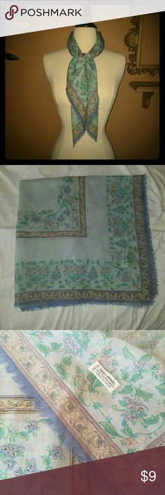 100% wool floral square scarf Light blue scarf with green leaves and lavender flowers with yellow accents. Tan border and lavender Fringe around edges. 2 small spots on scarf are not noticeable when wearing and might come out. Approx 31sq in. Accessories Scarves & Wraps