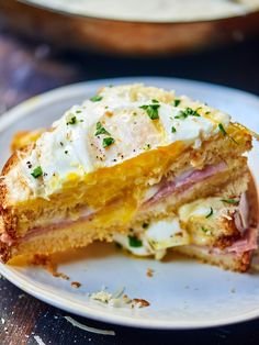 Croque Madame: - a classic french sandwich made with sweet brioche, salty ham, sharp gruyere and topped with a bechamel sauce, more cheese, and a fried egg!