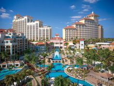 Resorts: Gorgeous Contemporary Modern Bahamas Resort With Wooden Sunbed With White Cushions White Umbrella With Tall Coconut Trees With Cool Seashore Scenery Outdoor Furniture Luxurious Hotels Sweet Fountains: Bahamas Resorts : The Stunning Tourist Destination Nowadays